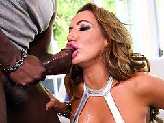 Naughty Richelle can't wait to taste her ebony partener's big appetizing cock. The luscious milf also exposes a pair of fascinating boobs, while licking and sucking dick. See her getting hotter, as the horny guy stuffs his dick down her throat... Have fun and enjoy the spicy details!