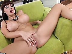 Brunette Aletta Ocean with gigantic hooters has fire in her eyes as she strokes her love box