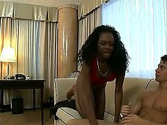 Tianna Love is a black babe that is on the sofa with a white dude. She is giving him a blow job and is getting a facial while having an interracial hump.