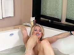Adorable blonde is massaging her pussy lips close up to the camera. She has a shaved pussy that is getting a lot of attention in this short movie along with her natural tits.