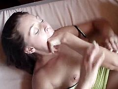 Two girls roll around on the bed sheets. Gracie Glam and AJ Applegate are kissing each other and doing feet worship. The lovely ladies are foot fetishists. Close up.