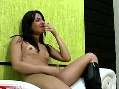 The more feminine tranny Leticia pumped and played with her large cock and petite tits, the harder she got and it was not long before this trans was filling the condom with big load of sperm...