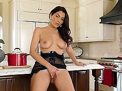 Valentina Nappi is a sweet solo girl that is resting her perfect ass down on a kitchen counter. She opens her legs to place a blue dildo on her pink pussy. Her pussy is hairy.