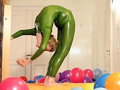 Contortionist blonde plays with balloons