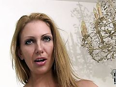Mature Leigh Darby with huge jugs and hairless twat fucks herself like mad in solo scene