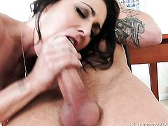 Brunette asian Jessica Jaymes keeps her mouth wide open while taking cumshot