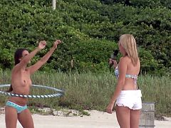 The group of sexy and fuckable babes are having a very good time down at the beach. Enjoy the sun and have some fun with the hula hoop. Even better - do it naked! They are rewarded with cash for the public nudity.