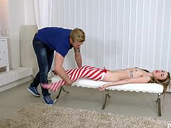 This guy's got a parcel. It is a huge cardboard box and it stands on the floor in the center of the room. Anything can be inside... but there is a real live doll there! Totally naked, in red white striped stockings. It seems, this guy intends to make a sex doll out of her.