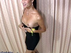 Oriental ladyboy plays with her tits while stroking shecock
