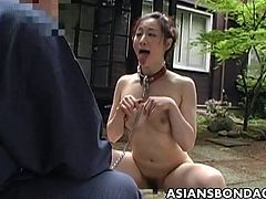 She has a master and the dude is treating her as if she is a dog. She is a bitch actually and she goes along with the program. She is nude the whole time.