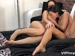 Two lesbians start out by 69ing and move on to using their huge hitachi vibrator, to get each other off. The sex is so invigorating that they soon have to squirt out piss and pussy juice into crystal glasses.