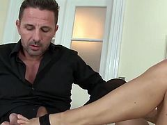 Sheila Grant in stockings gives footjob to lucky dude