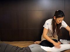 Japanese business hotel massage featuring exhausted customer and an older masseuse who flips over exposing bulge leading to a surprise handjob and more in HD with English subtitles