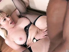 Adrianna Nicole has fire in her eyes while sucking mans hard sausage
