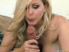 Milf Julia Ann with gigantic boobs has fire in her eyes as she gets her mouth drilled by her bang buddy