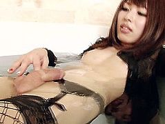 Japanese t-girl keeps her fishnets on during the time that jerking her penis