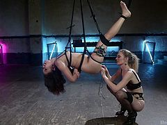 Bound with special ropes, Annie was hanging in the middle or the room, head down. It felt like a weightlessness, except this painful sensation in her asshole, caused with electric butt plug. Mona carefully licked the slave's pussy, trying to minimize the pain. Interracial lesbian electro bdsm!