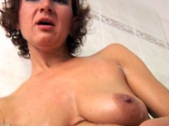 Soapy milf fingers her pink cunt in the shower