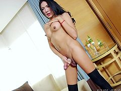 Nan is a petite Thai ladyboy with a smoking body, but there is one part of her that is huge. The Asian beauty has a long dick, that looks so suckable. She gets an erection immediately and beats off her cock furiously.