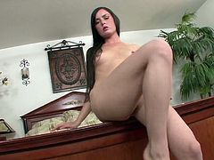 This horny milf is not going to lose her time without a hard dick, she tries to play by her own. She gropes her tits outdoors and gapes her ass, but it's not enough for such a wild hungry panther, so she moved into the house, where she fingers herself deeply, trying to reach the bottom of her deep wet cave. Hot!