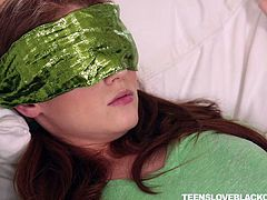 She may have been blindfolded, but this hot redhead teen knew right away, she was sucking on a big black cock. The size was a giveaway. Alice loves to get plowed by big black cock so hard in her pussy.