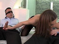 Blindfolded and ready to cum, the men lie back and let Tina work her magic with her hands. She has one cock in each hand and jerks them hard and fast. She gives each man a chance to get sucked off by her, too.