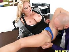 Blonde Charity Mclain with big hooters and bald bush lets man insert his pole in her mouth