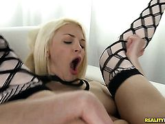 Blonde with shaved snatch has fire in her eyes as she plays with herself