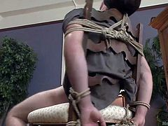 Logan cannot see the guys, that have him tied up and are teasing his cock relentlessly, not letting him cum, when he gets so close to doing so. They even put it in some sort of tubular thing, to get him going again.