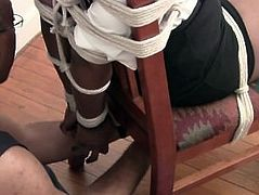 Ebony Babe tied to a Chair and gagged