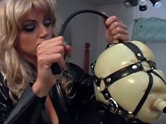 Latex loving mistress puts her maid in a hood