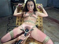 Roxanne's ok with the ropes and the vibrator, that's tied securely in place to her clit, but those clamps on her nipples and pussy lips hurt. She's getting the full mix of both arousal and pain, and you can be sure, she will be sore tomorrow.