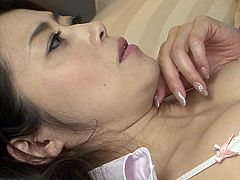 Are you into crazy lesbians? These two Japanese ladies are alone and the atmosphere gets hotter, as the horny milf helps shy Reiko undress. The bitch literally rips off her shirt, to see those big boobs and suck them passionately.