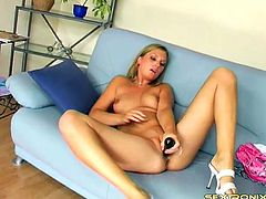 Lucka a great babe in jeans has a big black rod to insert her pussy with it
