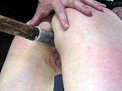 A stud was hired to brutally punish Casey Calvert, who cheated her husband. The executor tortured her pussy, by spreading the vertical lips really wide and placed a vibrator on clit. He restrained and slapped her, inserted a dildo in tiny asshole, and didn't allow her to reach an orgasm.
