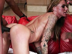 Blonde wench with huge jugs enjoys some passionate interracial sex
