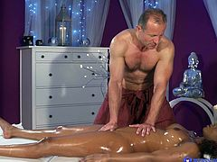 Jasmine's naked oilly body is a huge turn on for the skillfull masseur. It doesn't take long, until this foxy redhead ebony milf starts sucking dick passionately. Click to watch the slutty bitch pounded hard, from behind!