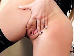 With tiny tits and trimmed beaver has fire in her eyes as she masturbates