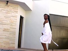 Tamires Vidall is a lovely Latin tranny chick with very long hair, a hard body and a plump shemeat that she loves playing with. She strips out of her robe showing off every inch of her dark skin...