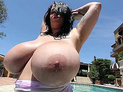 Naughty Leanne has the most great to look at and play with big natural boobs. Out in the sun, this hot brunette pinup girl, exposes her body with generosity, in front of the camera. Dare to watch and enjoy the scenes!