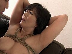 Her hands are tied and there are ropes crisscrossing her body. It's time for Hitomi to really give her husband his fullest desire, so he ties her up and opens her legs, so he can lick her pussy like never before.