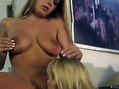 Pair of seductive blondes having an oral adventure together