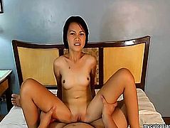 POV clip with a small Oriental beauty riding a pecker in a bedroom