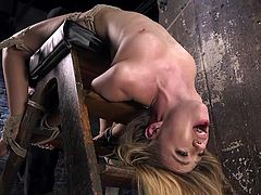 Watch pretty blonde babe Lyra Law, placed on a special bondage device head down and tied there with hard rope. Long dildo penetrates her cunt deeply, as the master stimulates her clit with electric vibrator. Then, for extra pleasure, he pinches her nipples and... Have fun and enjoy!
