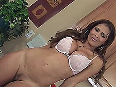 Fake-tit dark brown Monique Fuentes is posing