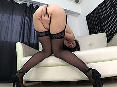 Experienced lady takes down her black lingerie and masturbates