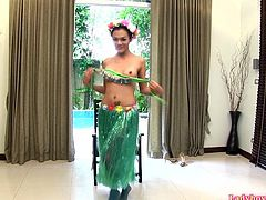 Ladyboy Cindy dressed in a Hawaiian grass skirt and lacy green pantyhose. She does a little dance swaying her hips then strokes her big dick. Cindy impales herself fully on a large realistic dildo and sucking cameraman's dick.