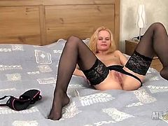 Hot blonde mom gleefully shows off her pussy