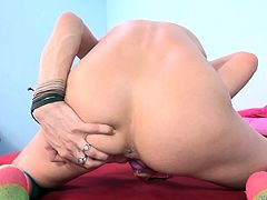 Insatiable solo chick Aiden Ashley fucks herself with sex toys