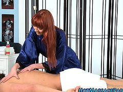 Redhead massages cock